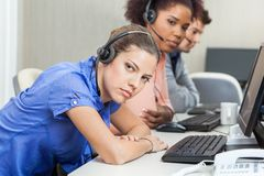 Tired Customer Service Representatives At Desk Stock Photos