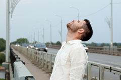 Tired cute man portrait stand on bridge Stock Photo