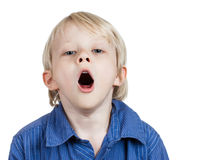 Tired cute young boy yawning. Royalty Free Stock Image