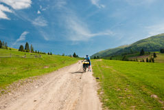 Tired cyclist. Hiking in the mountains. Royalty Free Stock Photo