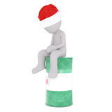 Tired 3d man sitting resting on an oil drum. Tired 3d man sitting resting on a green Castrol oil drum in a red Santa hat looking down at the ground, isolated Royalty Free Stock Image