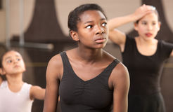 Tired Dance Students. Overwhelmed young ballet students at dance class stock photos
