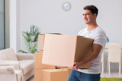 The tired delivery man with box Stock Images