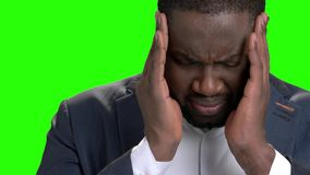 Tired and depressed businessman with headache. Unhappy dark-skinned entrepreneur suffering from migraine close up. Stess and health problem stock video footage