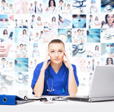 Tired and depressed doctor in medical office. Hard working and stress concept royalty free stock photo