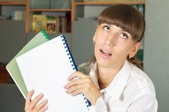 Tired and depressed student girl with his works Royalty Free Stock Images