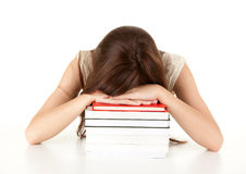 Tired, depressed student girl leaning on books Stock Photos