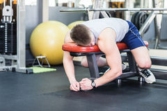 Tired and desperate men at the gym stock photography