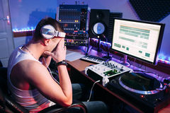 Tired DJ after overtime in studio Royalty Free Stock Photo