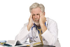 Tired Doctor With Headache Stock Photos