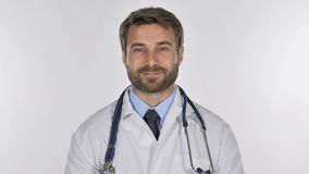 Tired Doctor Looking at Camera in Studio on White Background stock footage