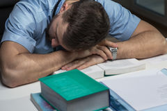 Tired doctor sleeping on desk Stock Images