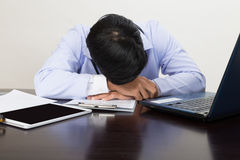 Tired doctor sleeping on his deck at medical office Stock Photo