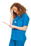 Tired doctor woman with clipboard Stock Photos