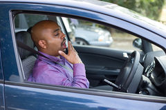 Tired driver. Driver yawning in his car Royalty Free Stock Photos