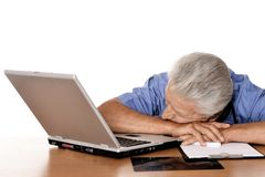 Tired elderly doctor royalty free stock photography
