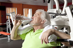 Tired elderly man on a fitness training with bottle of water Stock Photography