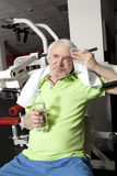 Tired elderly man on a fitness training with bottle of water Stock Photo