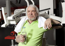 Tired elderly man on a fitness training with bottle of water Royalty Free Stock Photography