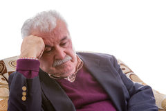 Tired elderly retired man sitting thinking Royalty Free Stock Image