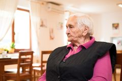 Tired elderly woman Stock Photos