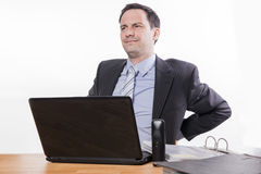 Tired employee having back pain royalty free stock photo
