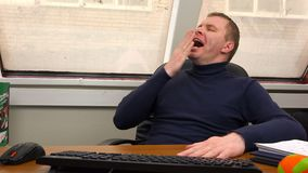 Tired employee leaned back in his chair in the workplace.  stock footage