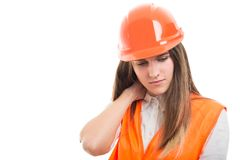 Tired engineer girl massaging her neck Stock Image