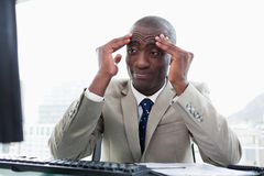 Tired entrepreneur working with a computer Royalty Free Stock Photography