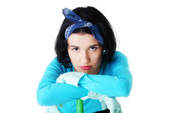 Tired and exhausted cleaning woman portrait Royalty Free Stock Image
