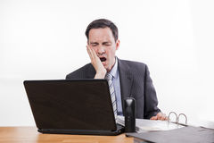 Tired and exhausted employee yawning royalty free stock photography