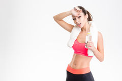 Tired exhausted fitness girl  bottle of water Royalty Free Stock Photography