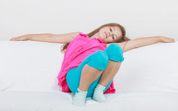 Tired exhausted lazy little girl kid lying on sofa Stock Photography