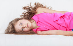 Tired exhausted lazy little girl kid lying on sofa Royalty Free Stock Photo