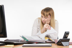Tired falls asleep digging a specialist office folders with documents Stock Image