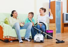 Tired family after cleaning Royalty Free Stock Image