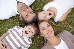 Tired family lying in a park Royalty Free Stock Image