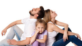 The tired family sitting on white background Stock Photo