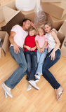 Tired family sleeping lying on the floor Royalty Free Stock Photos