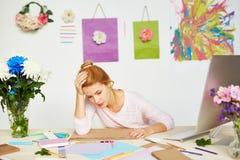 Tired fashion designer in studio stock images