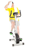 Tired fat woman on  fitness bicycle Stock Photos