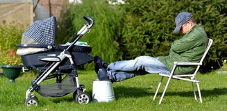 Tired father with stroller Royalty Free Stock Images