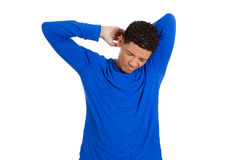 Tired fatigued man stretching arms, back shoulders and hands Royalty Free Stock Photography