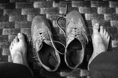 Tired feet. Black and white photo; tired feed, old shoes Royalty Free Stock Photos