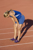 Tired Female Athlete On Racing Track Stock Images