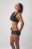 Tired female boxer relaxing after a workout Stock Photography