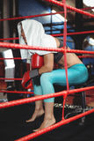 Tired female boxer sitting in the ring Royalty Free Stock Photos