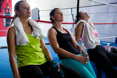 Tired female boxers leaning on rope. Tired female boxers leaning on boxing ring rope Stock Image