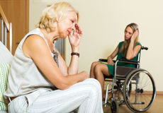 Tired female and disabled person Royalty Free Stock Images