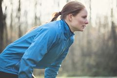 Tired Female Jogger stock photo